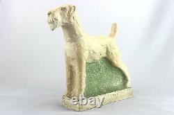 A vintage studio pottery sculpture of an Airedale Terrier. Signed. Art Deco era